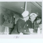 1957-58, Sidney Hermanson, SN (back to camera) and 1957, Kenneth Holcomb, EN3 (1957) at Restaurant in DeTour Village