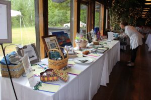 Silent Auction table resulted in energetic bidding
