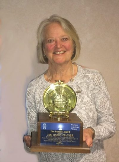 Jeri Baron Feltner with the Beacon Award presented to her by the Michigan Lighthouse Alliance